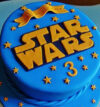 attachment-https://cakewithus.com/wp-content/uploads/2021/03/classic-blue-and-orange-star-wars-birthday-cake-1.5-kg-230-aed-600x600-2-100x107.jpg