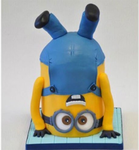 attachment-https://cakewithus.com/wp-content/uploads/2021/03/minion-upsidedown-cake-5-kg-700-aed-600x600-2-458x493.jpg