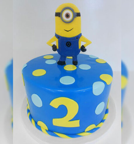 attachment-https://cakewithus.com/wp-content/uploads/2021/04/minion-is-turning-2-2-kg-300-aed-458x493.jpg